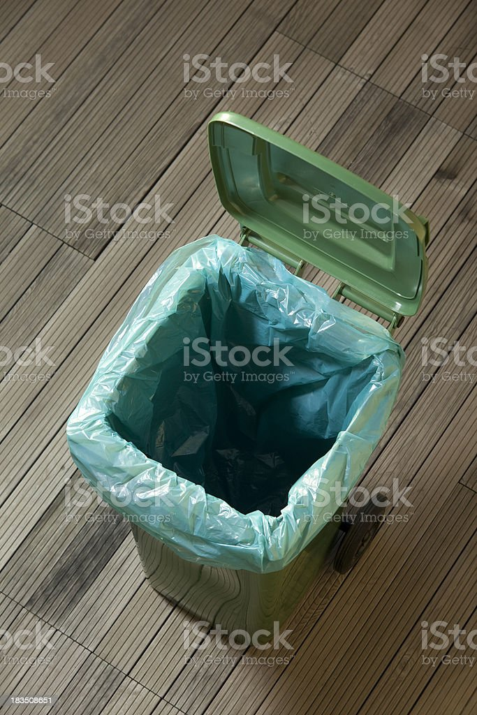 Green plastic trash can stock photo