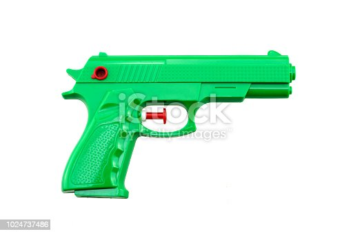 green plastic water toy gun shaped like a real one on white background