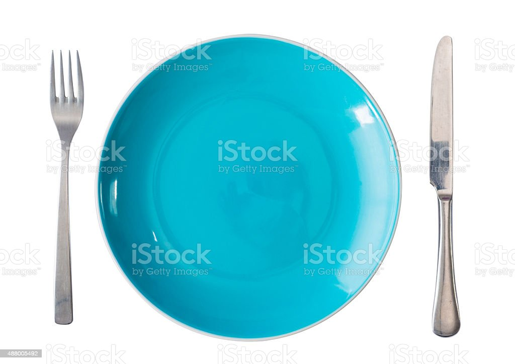 green plate with fork and knife stock photo