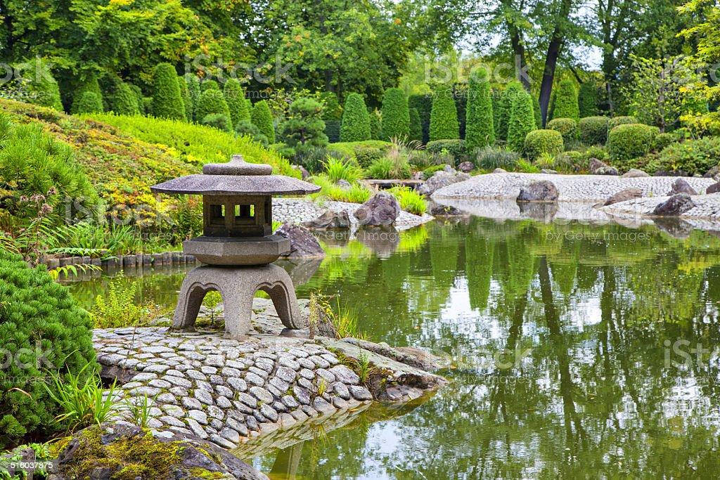 Green pond in Japanese garden stock photo