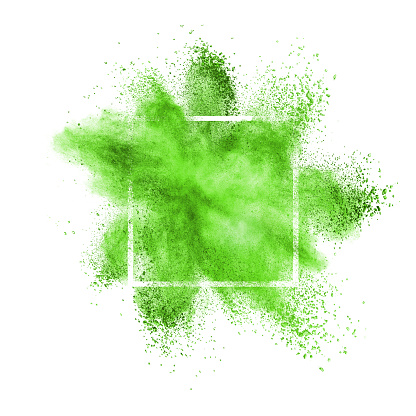 Green dust or powder explosion in a square frame on a white background, copy space.