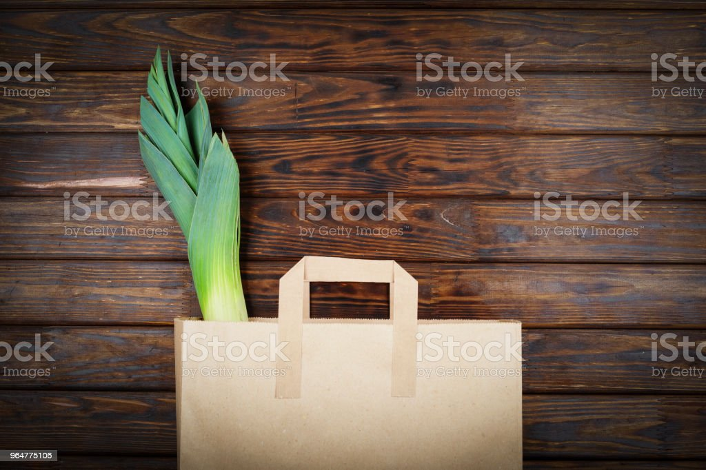 Green products, Healthy food, leek, vegetarian, paper bag, Supermarket, food delivery, top view, copy space royalty-free stock photo