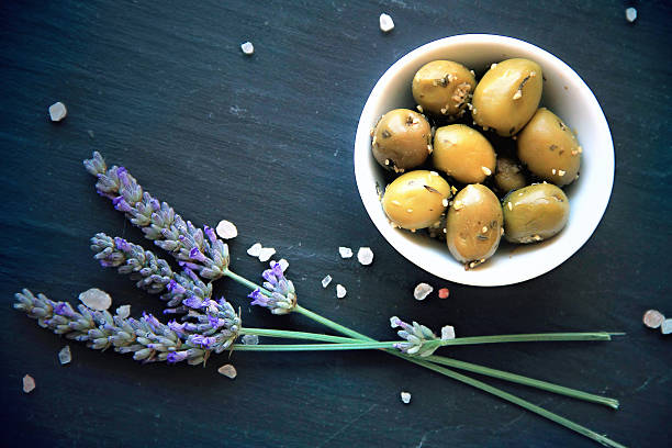 green Provencal olives with herbs de Provence stock photo