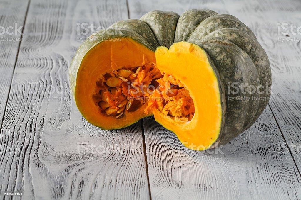 Green pumpkin on the white background stock photo