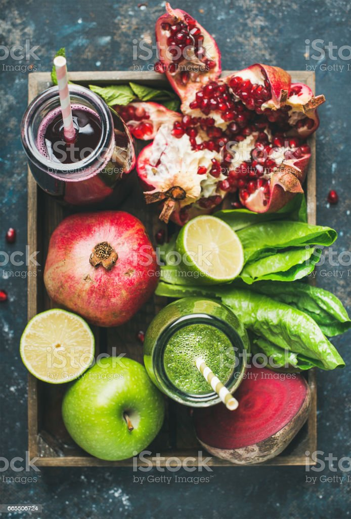 Green, purple fresh juices with fruits, greens, vegetables in tray stock photo
