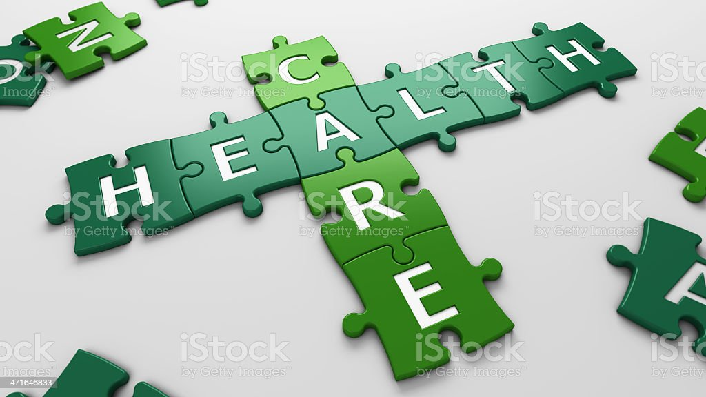 Green puzzle pieces spelling healthcare on white royalty-free stock photo