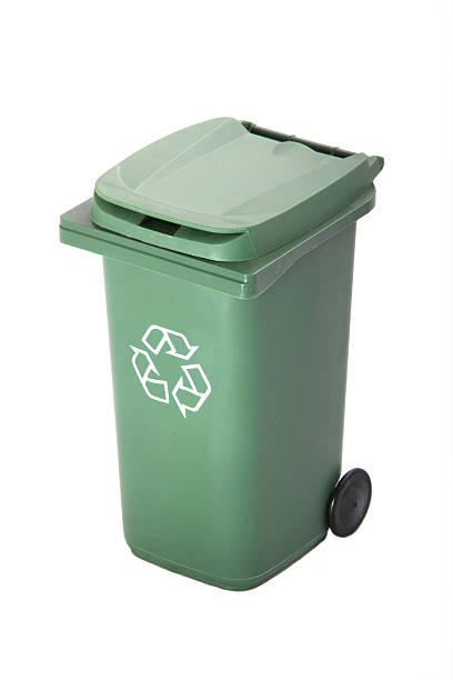 Green recycle rubbish or garbage bin with the recycle symbol. stock photo
