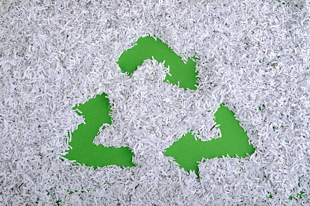 green recycle symbol - shredded paper stock photos and pictures