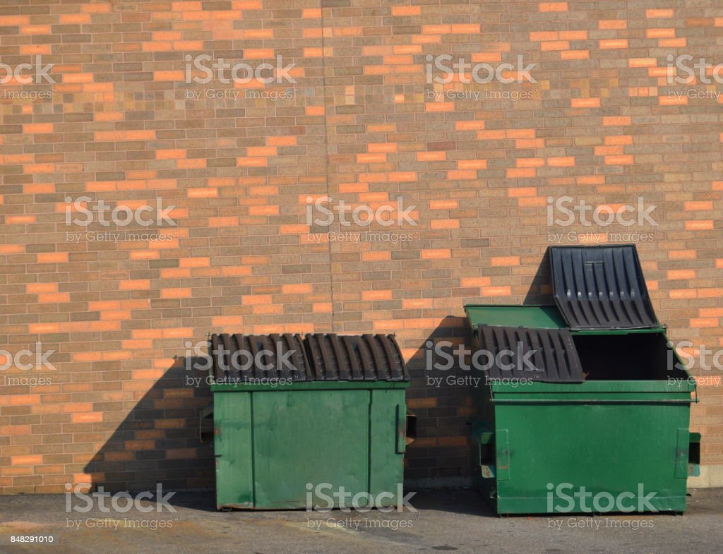 Green recycling dumpsters stock photo
