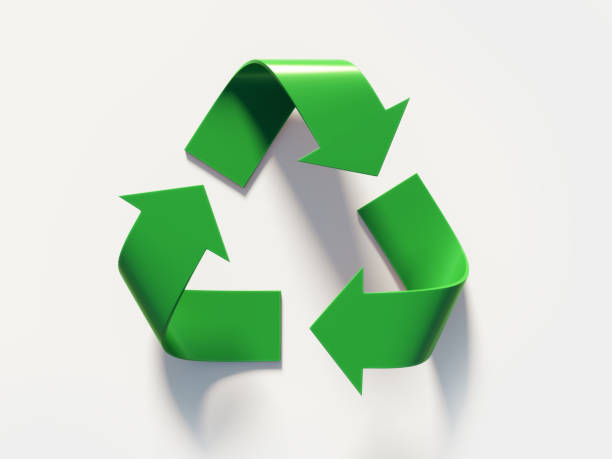 green recycling symbol on white background - recycling symbol stock photos and pictures