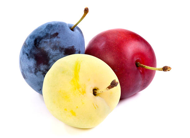 Green, Red, and Blue Plums stock photo