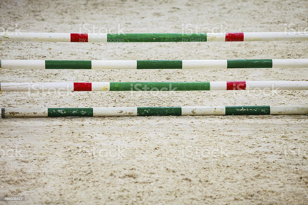 Green red white obstacle for jumping horses. Riding competition. stock photo