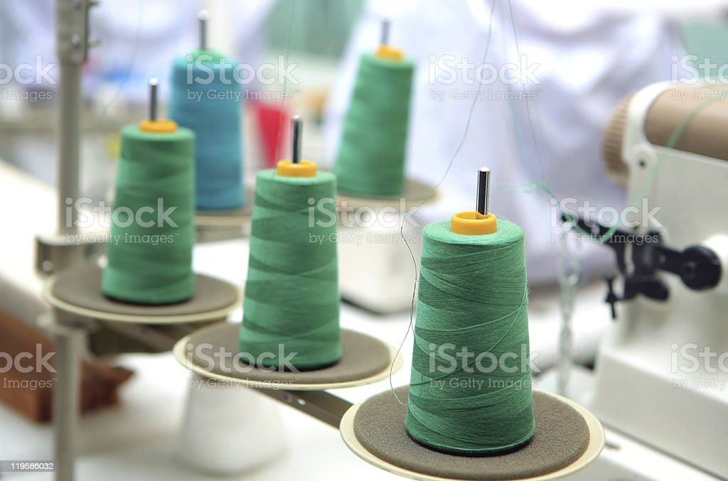 green reels of thread at tailor's royalty-free stock photo