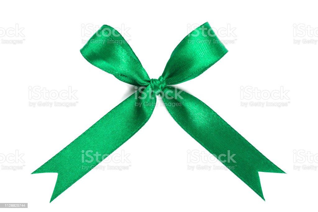 Green ribbon satin bow isolated on white background. stock photo