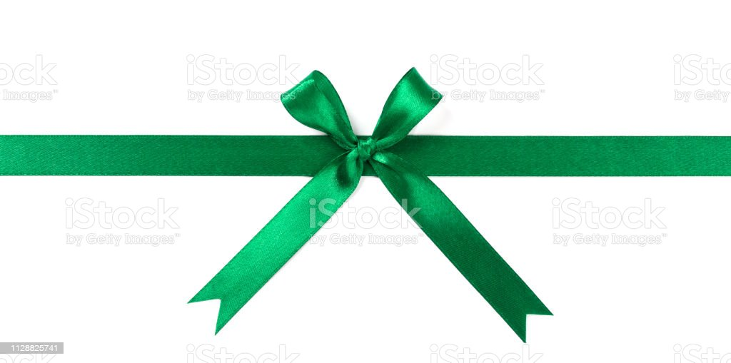 Green ribbon with bow isolated on white background. stock photo