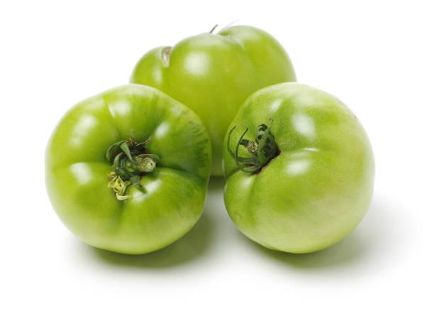 Green ripe tomatoes   on white background – zdjęcie