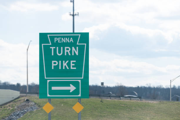 Green road sign to Penna Pennsylvania Turnpike highway toll freeway stock photo