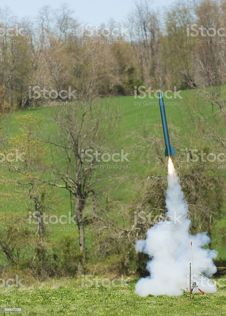 Green rocket blastoff stock photo
