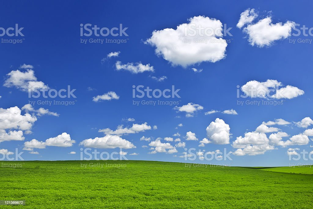 Green rolling hills under blue sky royalty-free stock photo