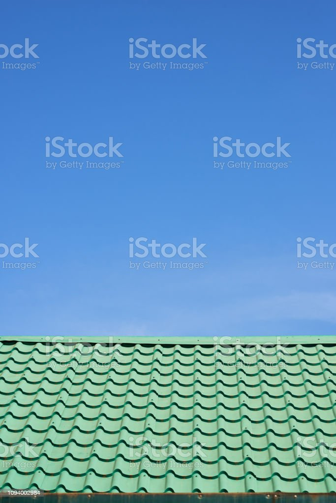 Vivid color of green roof and blue sky