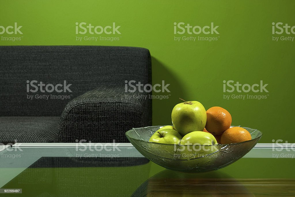 Green room, sofa and fruits in bowl royalty-free stock photo