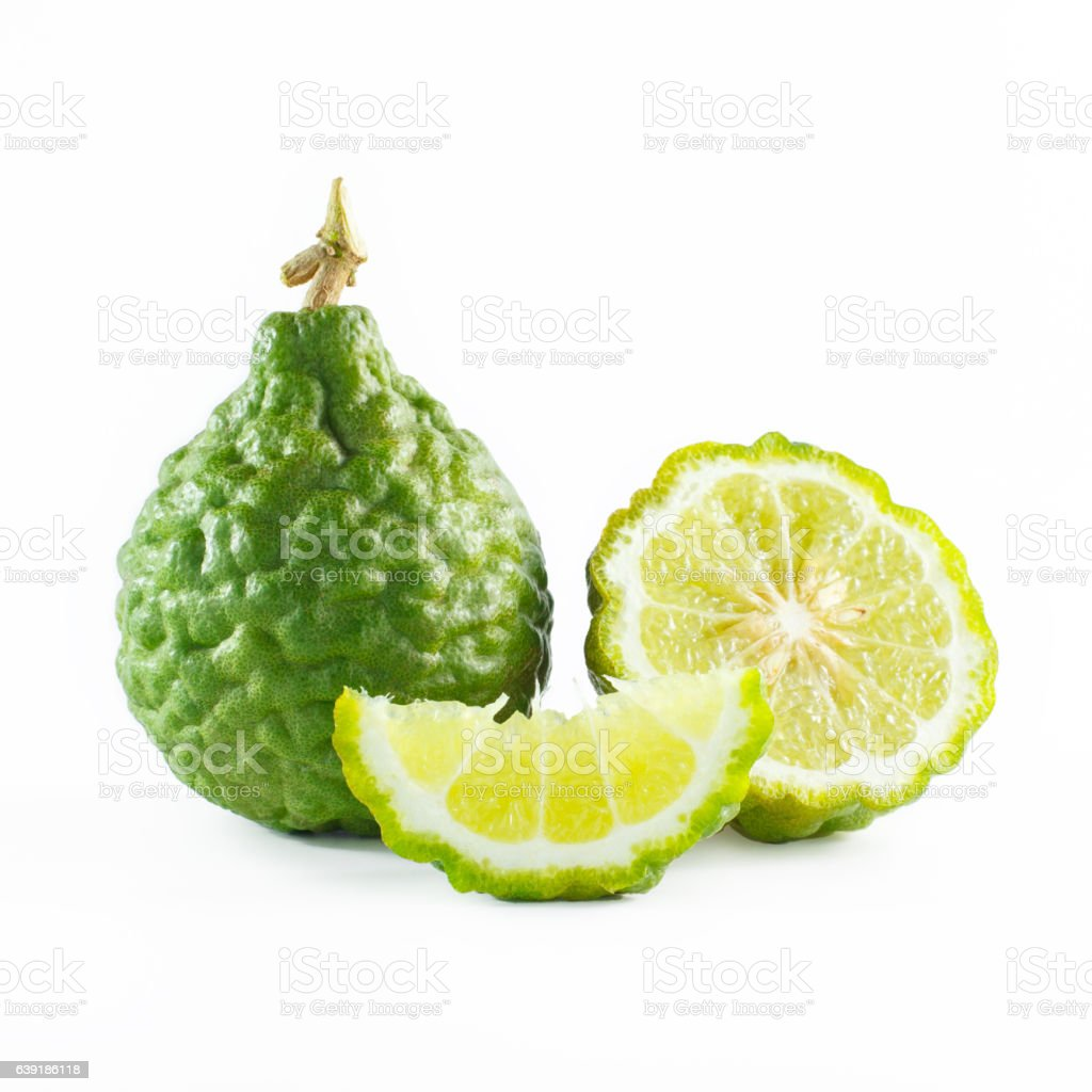 Green rough peel bergamot fruit or kaffir lime isolated stock photo
