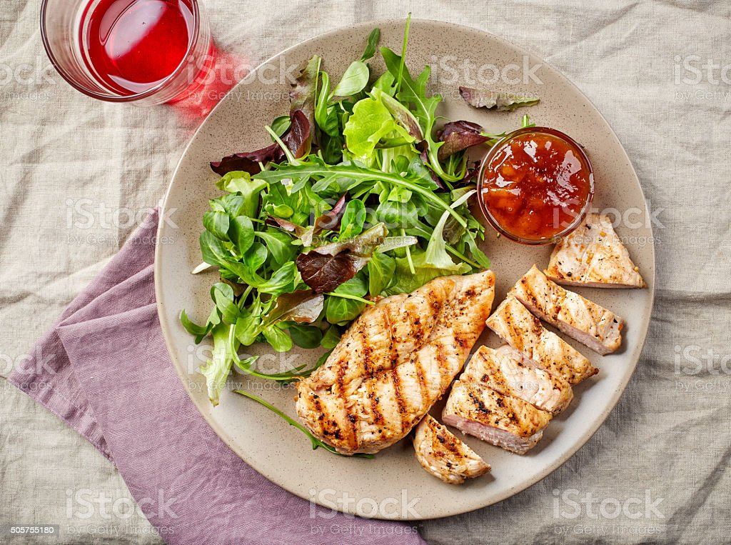 Green salad and grilled chicken fillet stock photo