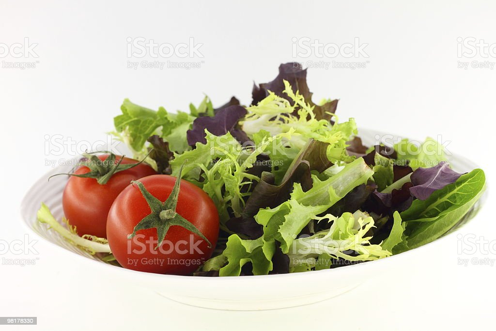 Green salad and tomatoes royalty-free stock photo