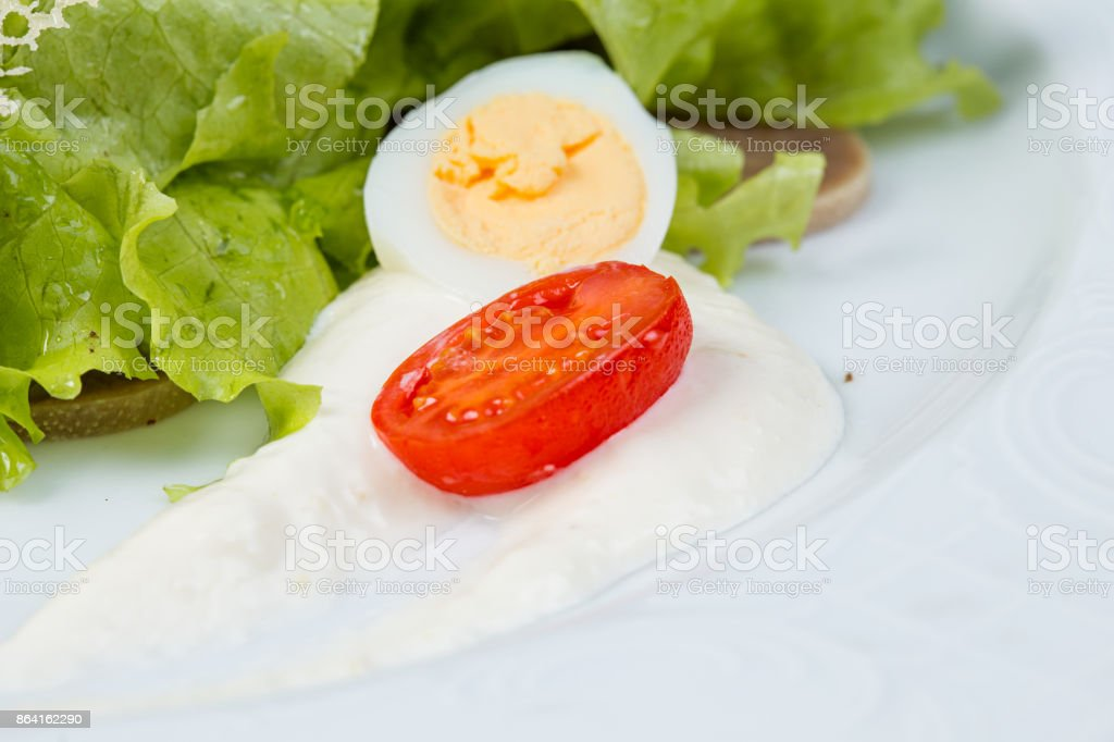 Green salad, tomato cherry and boiled egg royalty-free stock photo