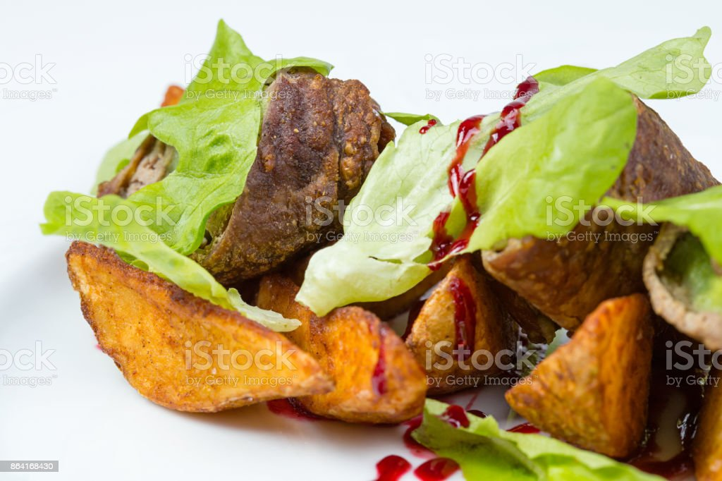 Green salad, veal and baked potatoes royalty-free stock photo