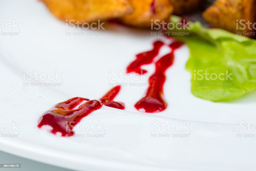 Green salad, veal and berry sauce royalty-free stock photo