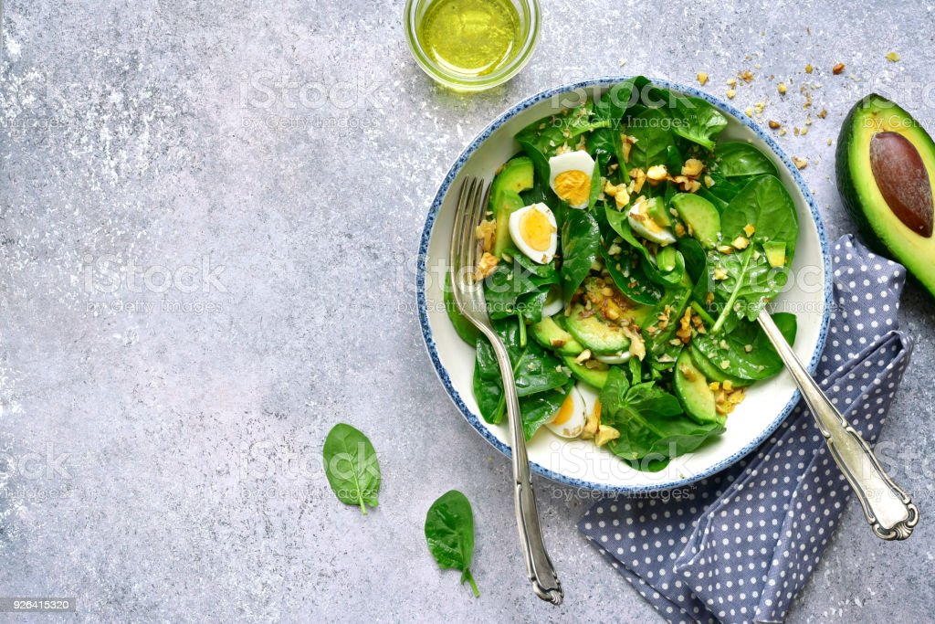 Green salad with boiled quail eggs and walnuts stock photo