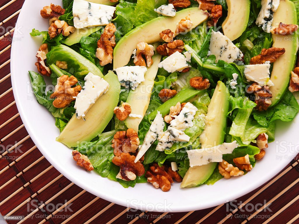 Green salad with cheese and pears stock photo