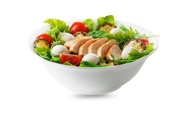 Green salad with chicken stock photo