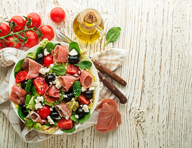 Green salad with prosciutto stock photo