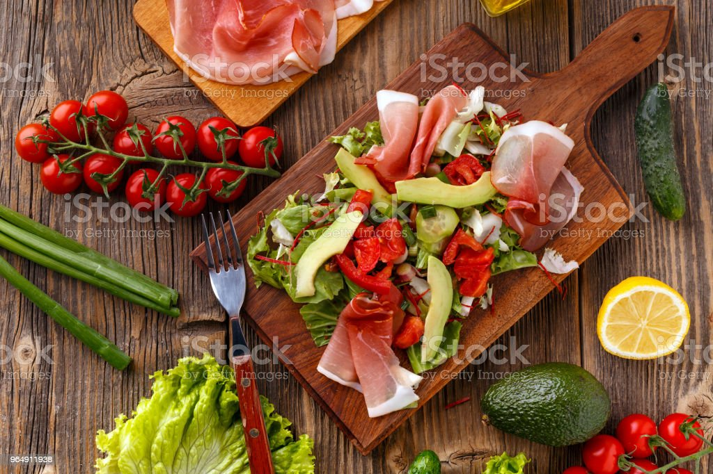 Green salad with prosciutto royalty-free stock photo