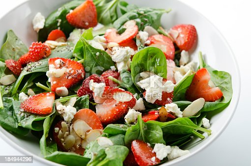 istock Green salad with strawberries and spinach 184944296