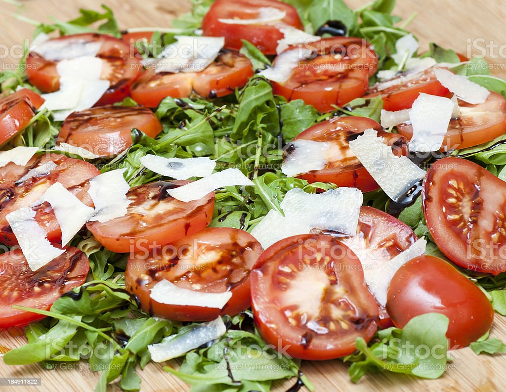 green salad with tomatoes and parmesan royalty-free stock photo