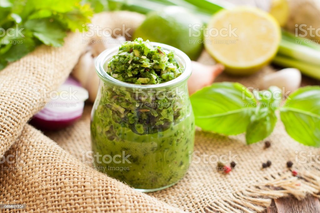 Green sauce in a glass jar - Royalty-free Backgrounds Stock Photo