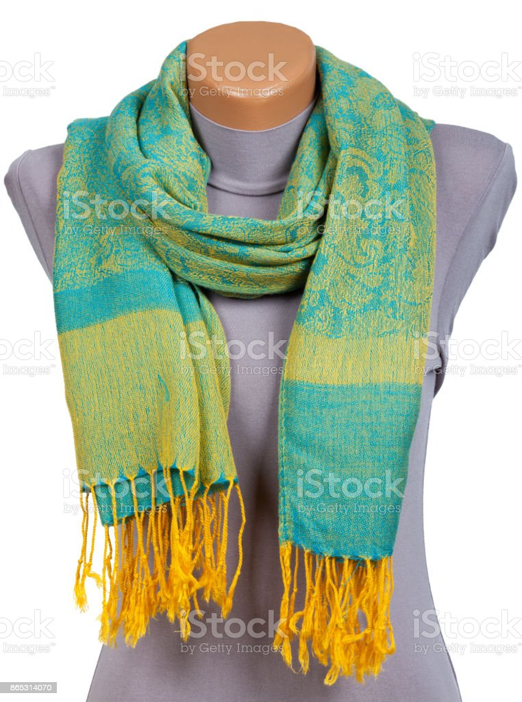 Green scarf on mannequin isolated on white background. stock photo