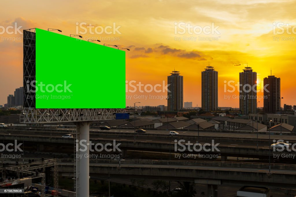 green screen billboard beside express way at beautyful sunset used for advertising