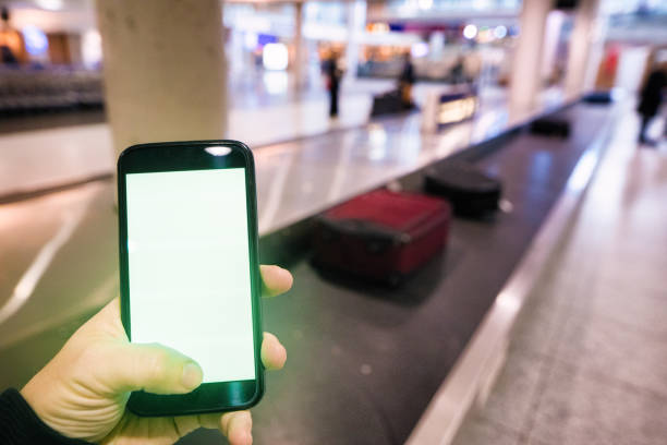 Green Screen Handheld Smartphone by male in airport stock photo