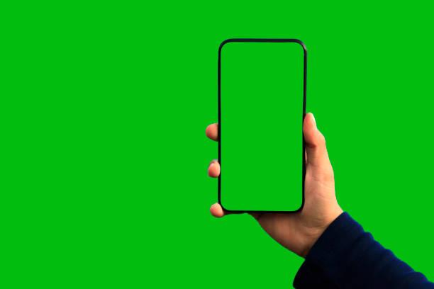 groene scherm handheld smartphone - green screen stockfoto's en -beelden