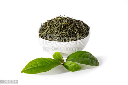 istock Green sencha tea in white cup with tealeaves 1066855514