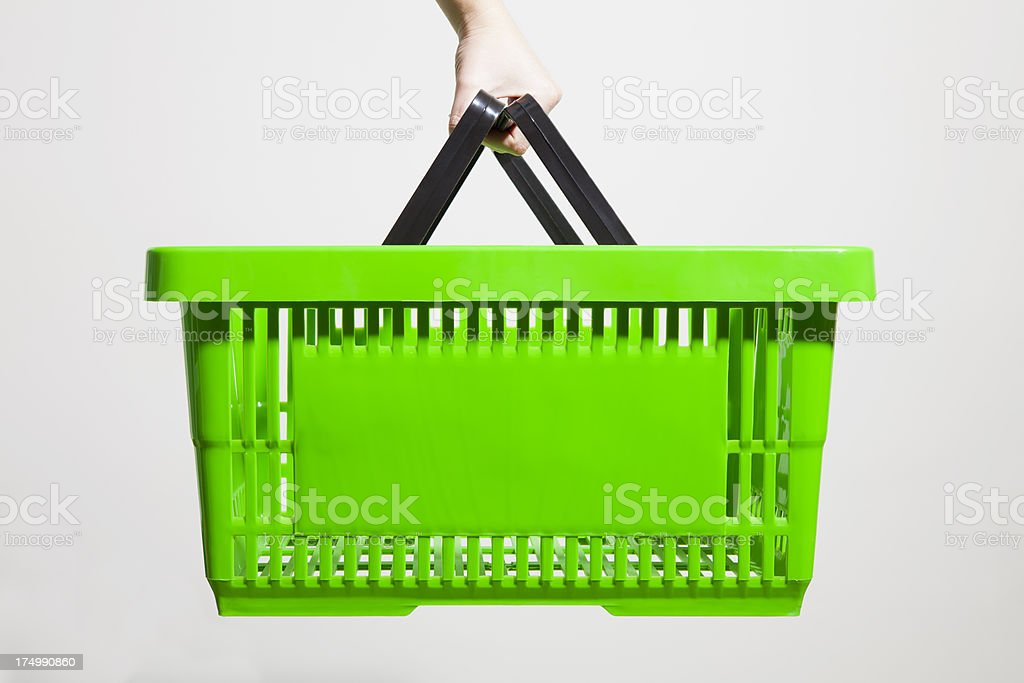 green shopping basket stock photo