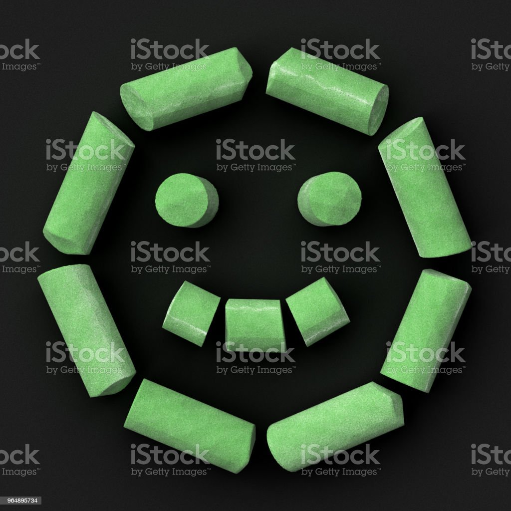 Green sidewalk or blackboard chalks assembled like face happy emoticon on rough blackboard, 3D rendered font image royalty-free stock photo
