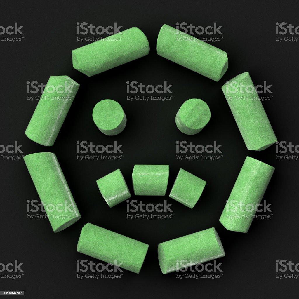 Green sidewalk or blackboard chalks assembled like sad face emoticon on rough blackboard, 3D rendered font image royalty-free stock photo