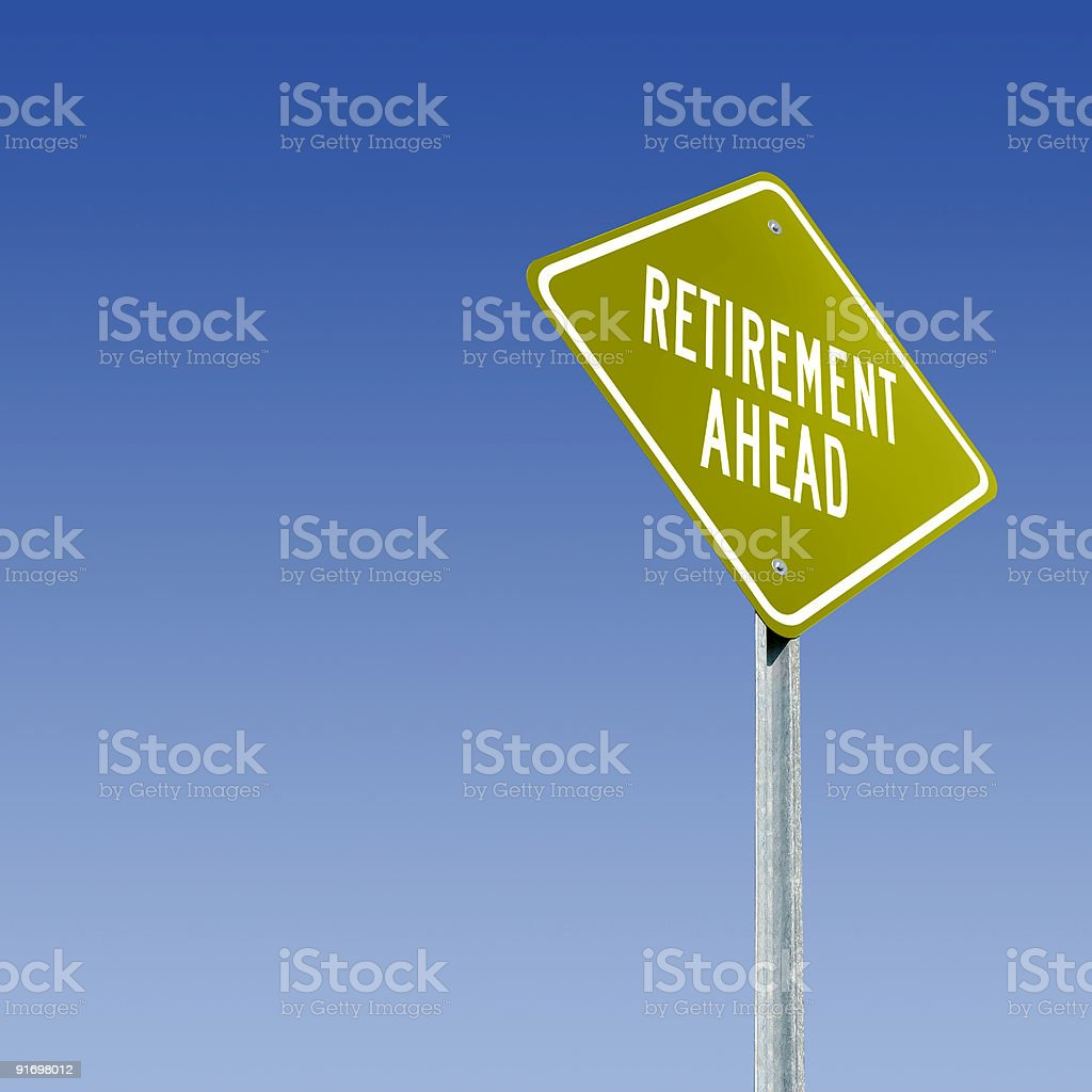 A green sign against a blue sky with Retirement Ahead on it royalty-free stock photo