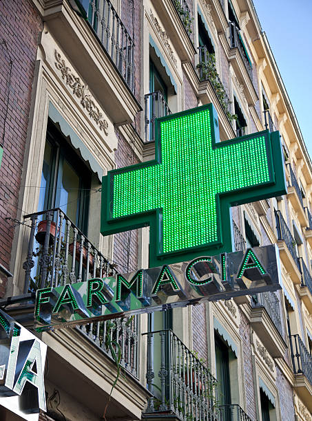 Green sign of the pharmacy in Madrid stock photo