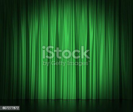 istock Green silk curtains for theater and cinema spotlit light in 607277872